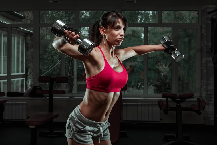 girl doing exercise with dumbbells